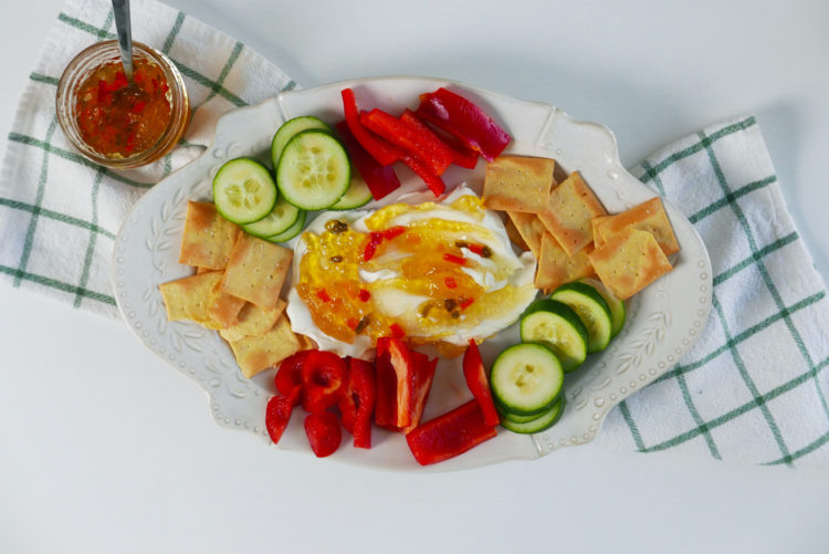 A Plate of Hot Pepper Jelly with Cucumbers, Cream Cheese, Red Peppers, and Crackers. Learn how to make our hot pepper jelly recipe