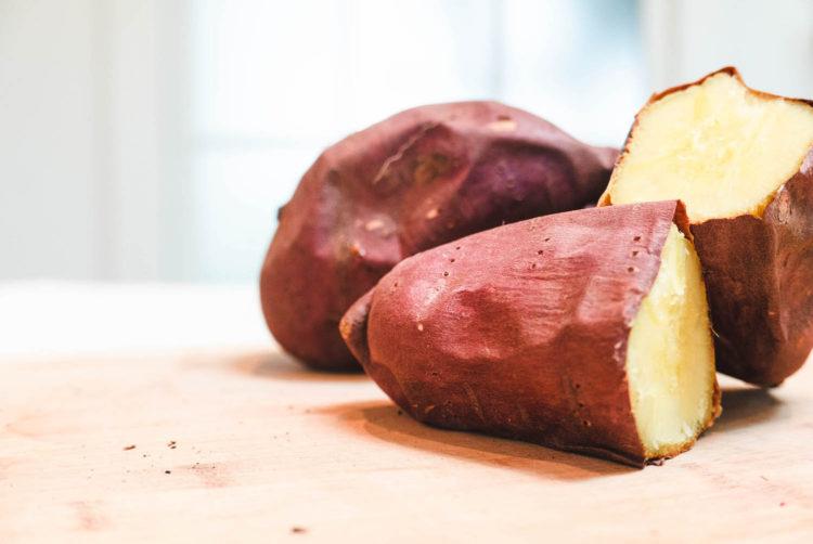 Korean Sweet Potatoes on a cutting board.