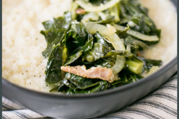 A close up shot of white grits with greens